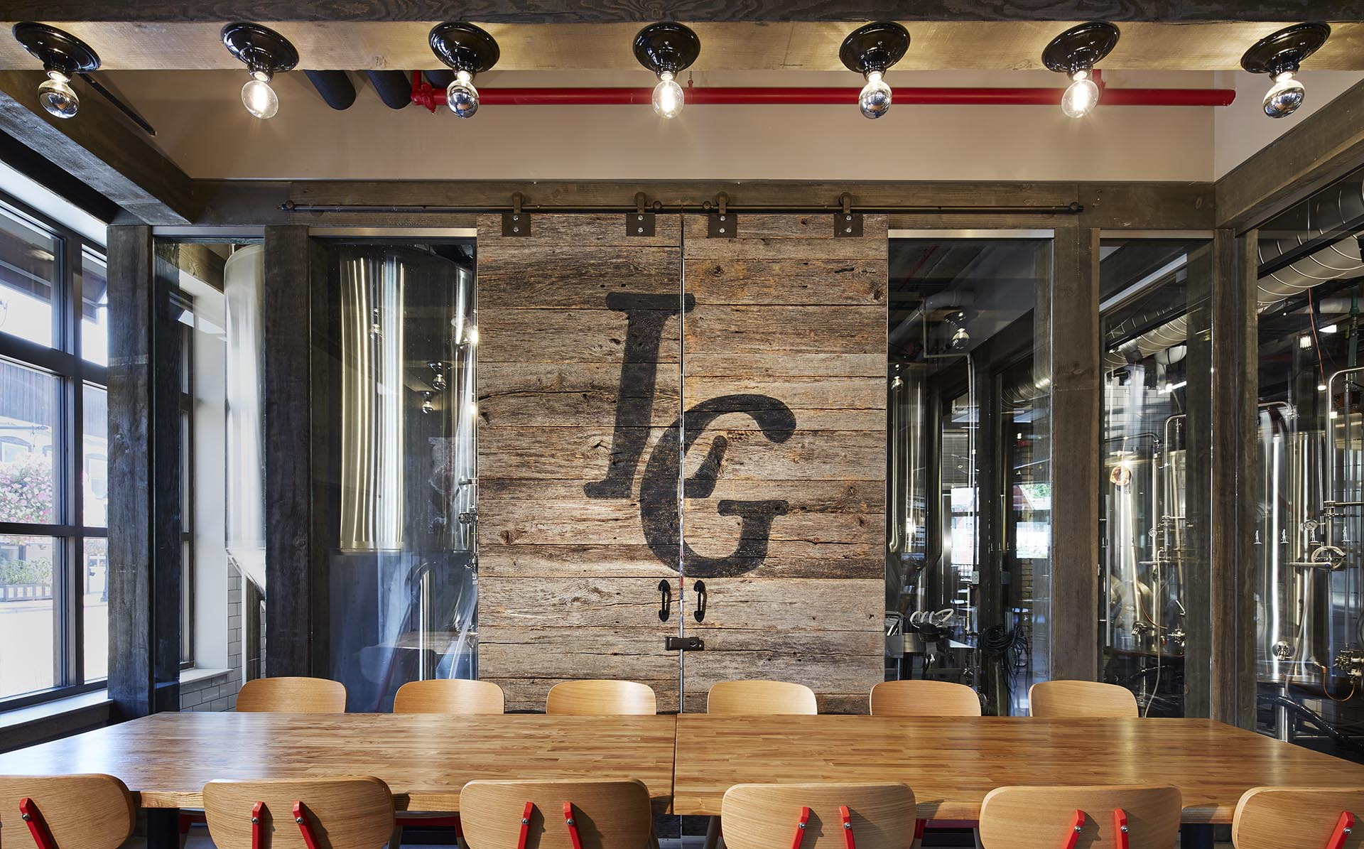 "Barn doors with the initials, ""LG"" burned into the wood"