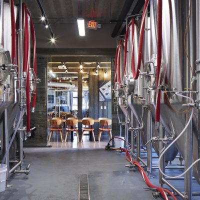 Rows of large stainless steel brewing vessels