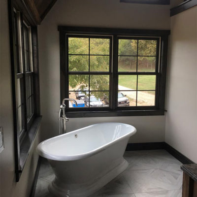 Bathroom with large white bathtub