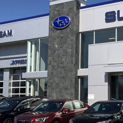 Subaru dealership with cars out front